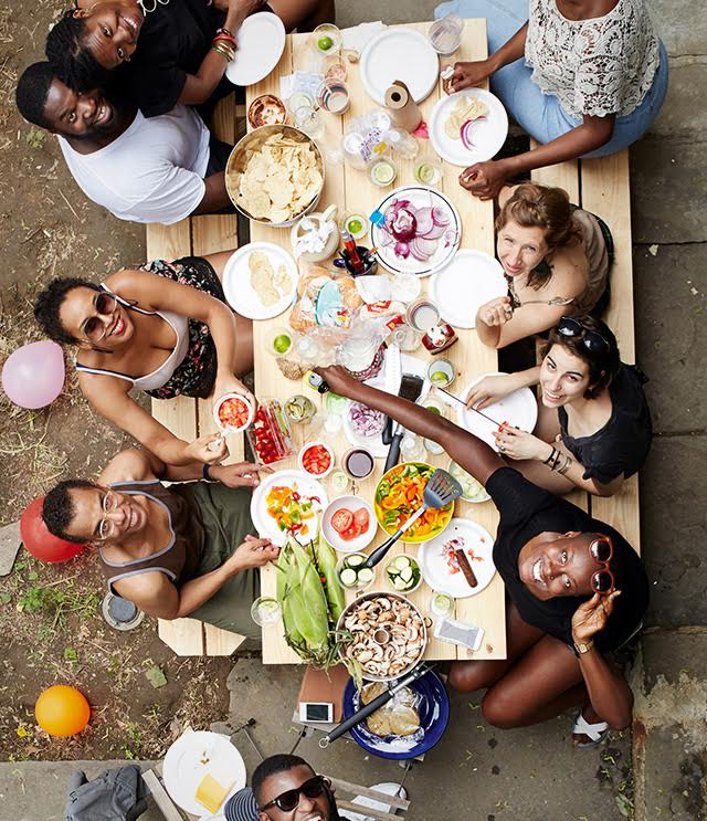 fun people around table for outdoor lunch